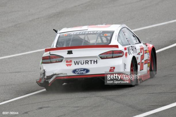 Brad Keselowski in the Ford shows evidence of a crack rear bumper after his second lap crash during the Monster Energy Cup Series 20th Anniversary...