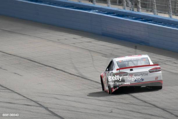Brad Keselowski in the Ford shows evidence of a repaired taped bumper after a second lap crash that resulted in a crack rear bumper during the...