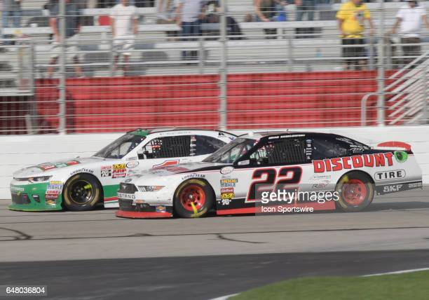 Brad Keselowski Penske Racing Discount Tire Ford Mustang and Elliott Sadler JR Motorsports Hunt Brothers Pizza Chevrolet Camaro racing side by side...