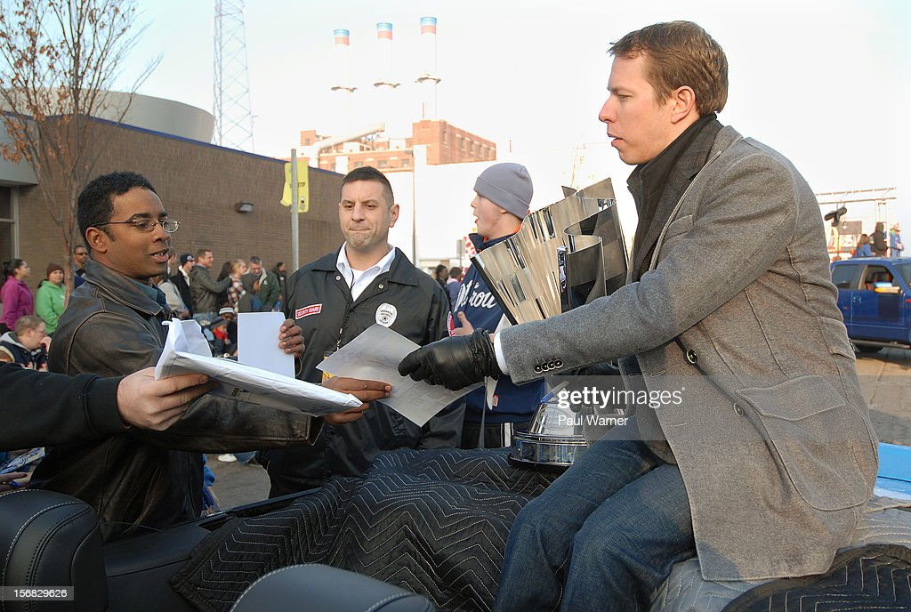 Brad Keselowski , the 2012 NASCAR Sprint Cup Champion from Rochester Hills, Michigan, signs autographs before participating in America's Thanksgiving Day Parade at Woodward Avenue on November 22, 2012 in Detroit, Michigan.