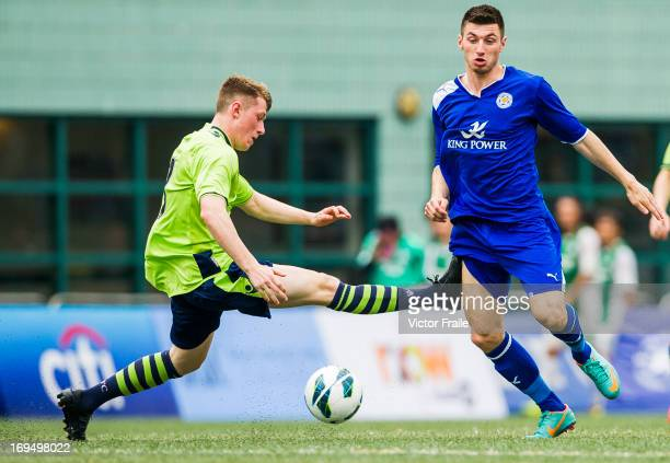 Brad Lewis of Aston Villa and Michael Cain of Leicester City fight for the ball on day three of the Hong Kong International Soccer Sevens at Hong...