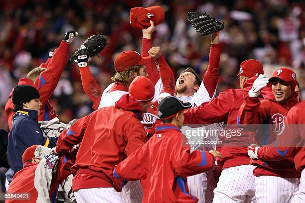 Brad Lidge of the Philadelphia Phillies celebrates with his teammates after their 43 win against the Tampa Bay Rays during the continuation of game...