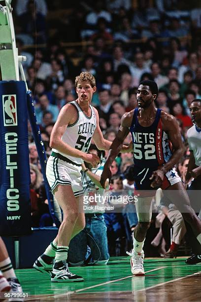 Brad Lohaus of the Boston Celtics defends against Buck Williams of the New Jersey Nets during a game played in 1988 at the Boston Garden in Boston...