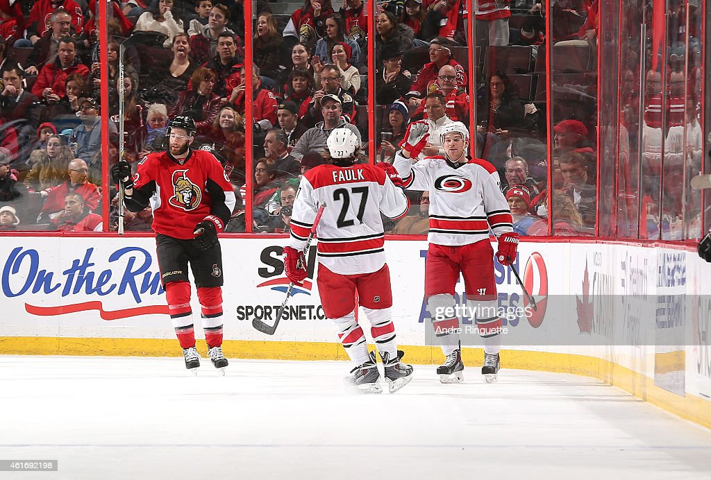 Brad Malone #24 of the Carolina Hurricanes celebrates his first period goal with teammate Justin Faulk #27 as <a gi-track='captionPersonalityLinkClicked' href=/galleries/search?phrase=Eric+Gryba&family=editorial&specificpeople=570539 ng-click='$event.stopPropagation()'>Eric Gryba</a> #62 of the Ottawa Senators reacts to the play at Canadian Tire Centre on January 17, 2015 in Ottawa, Ontario, Canada.