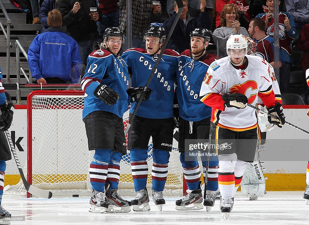 Brad Malone #42 of the Colorado Avalanche celebrates his first career NHL goal with teammates <a gi-track='captionPersonalityLinkClicked' href=/galleries/search?phrase=Jamie+McGinn&family=editorial&specificpeople=537964 ng-click='$event.stopPropagation()'>Jamie McGinn</a> #11 and <a gi-track='captionPersonalityLinkClicked' href=/galleries/search?phrase=Ryan+O%27Reilly&family=editorial&specificpeople=4754037 ng-click='$event.stopPropagation()'>Ryan O'Reilly</a> #90 against the Calgary Flames at the Pepsi Center on April 8, 2013 in Denver, Colorado.