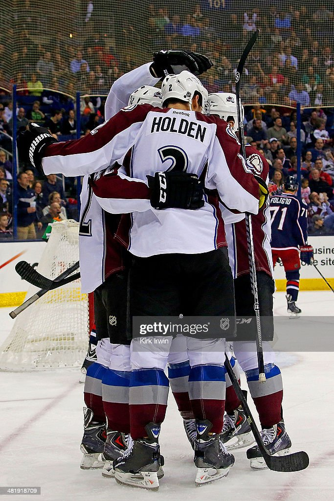 Brad Malone #42 of the Colorado Avalanche is congratulated by his teammates after scoring a goal against the Columbus Blue Jackets during the third period on April 1, 2014 at Nationwide Arena in Columbus, Ohio. Colorado defeated Columbus 3-2 in overtime.