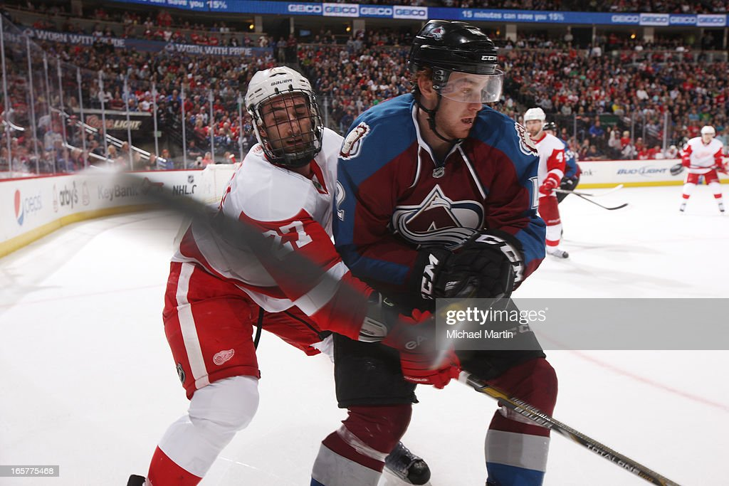 Brad Malone #42 of the Colorado Avalanche skates against <a gi-track='captionPersonalityLinkClicked' href=/galleries/search?phrase=Kyle+Quincey&family=editorial&specificpeople=2234340 ng-click='$event.stopPropagation()'>Kyle Quincey</a> #27 of the Detroit Red Wings at the Pepsi Center on April 5, 2013 in Denver, Colorado. Detroit beat Colorado 3-2 in overtime.
