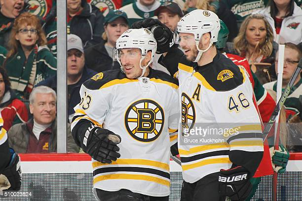 Brad Marchand and David Krejci of the Boston Bruins celebrate after scoring a shorthanded goal against the Minnesota Wild during the game on February...