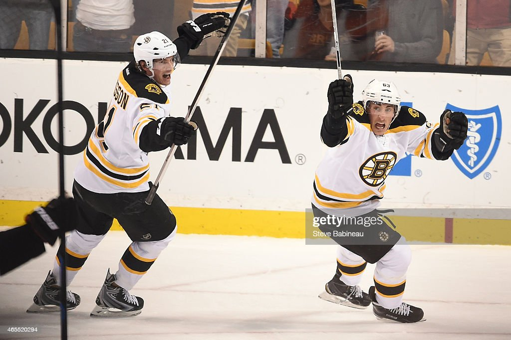 <a gi-track='captionPersonalityLinkClicked' href=/galleries/search?phrase=Brad+Marchand&family=editorial&specificpeople=2282544 ng-click='$event.stopPropagation()'>Brad Marchand</a> #63 and <a gi-track='captionPersonalityLinkClicked' href=/galleries/search?phrase=Loui+Eriksson&family=editorial&specificpeople=2235241 ng-click='$event.stopPropagation()'>Loui Eriksson</a> #21 of the Boston Bruins celebrate a goal against the Philadelphia Flyers at the TD Garden on March 7, 2015 in Boston, Massachusetts.