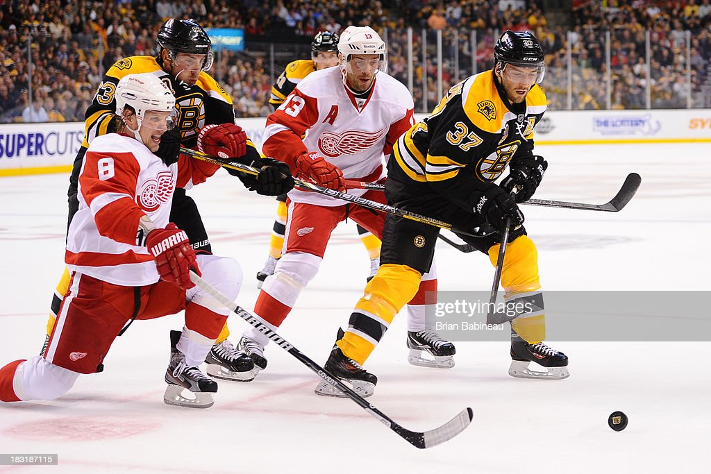 <a gi-track='captionPersonalityLinkClicked' href=/galleries/search?phrase=Brad+Marchand&family=editorial&specificpeople=2282544 ng-click='$event.stopPropagation()'>Brad Marchand</a> #63 and <a gi-track='captionPersonalityLinkClicked' href=/galleries/search?phrase=Patrice+Bergeron&family=editorial&specificpeople=204162 ng-click='$event.stopPropagation()'>Patrice Bergeron</a> #37 of the Boston Bruins fight for the puck against <a gi-track='captionPersonalityLinkClicked' href=/galleries/search?phrase=Justin+Abdelkader&family=editorial&specificpeople=2271858 ng-click='$event.stopPropagation()'>Justin Abdelkader</a> #8 and <a gi-track='captionPersonalityLinkClicked' href=/galleries/search?phrase=Pavel+Datsyuk&family=editorial&specificpeople=202893 ng-click='$event.stopPropagation()'>Pavel Datsyuk</a> #13 of the Detroit Red Wings at the TD Garden on October 5, 2013 in Boston, Massachusetts.