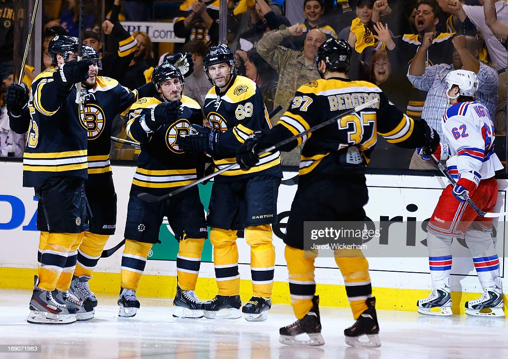 <a gi-track='captionPersonalityLinkClicked' href=/galleries/search?phrase=Brad+Marchand&family=editorial&specificpeople=2282544 ng-click='$event.stopPropagation()'>Brad Marchand</a> #63 celebrates with teammate <a gi-track='captionPersonalityLinkClicked' href=/galleries/search?phrase=Patrice+Bergeron&family=editorial&specificpeople=204162 ng-click='$event.stopPropagation()'>Patrice Bergeron</a> #37 of the Boston Bruins after scoring a goal in the third period against the New York Rangers in Game Two of the Eastern Conference Semifinals during the 2013 NHL Stanley Cup Playoffs on May 19, 2013 at TD Garden in Boston, Massachusetts.