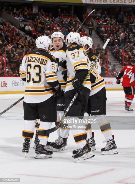 Brad Marchand Charlie McAvoy Patrice Bergeron and David Pastrnak of the Boston Bruins celebrate a second period goal against the Ottawa Senators in...