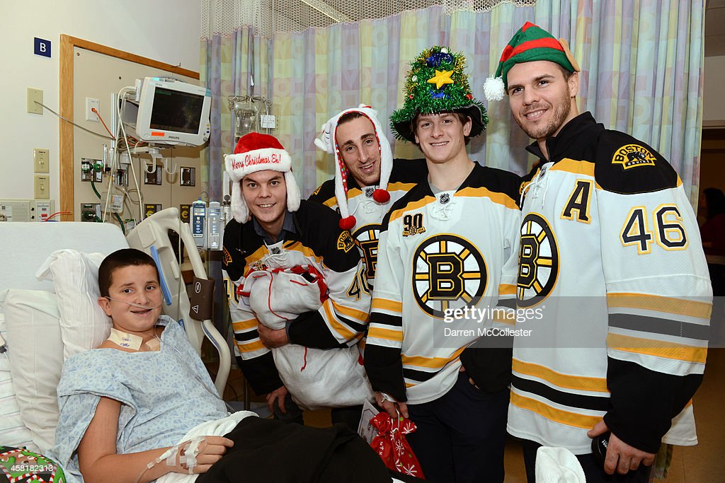 Brad Marchand David Krejci Tory Krug and Tuukka Rask of Boston Bruins enter caption here at Boston Children's Hospital on December 20 2013 in Boston...