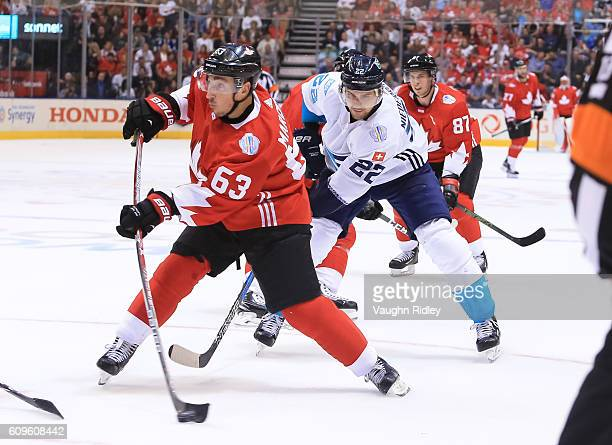 Brad Marchand fires a slapshot with pressure from Nino Niederreiter of Team Europe during the World Cup of Hockey 2016 at Air Canada Centre on...