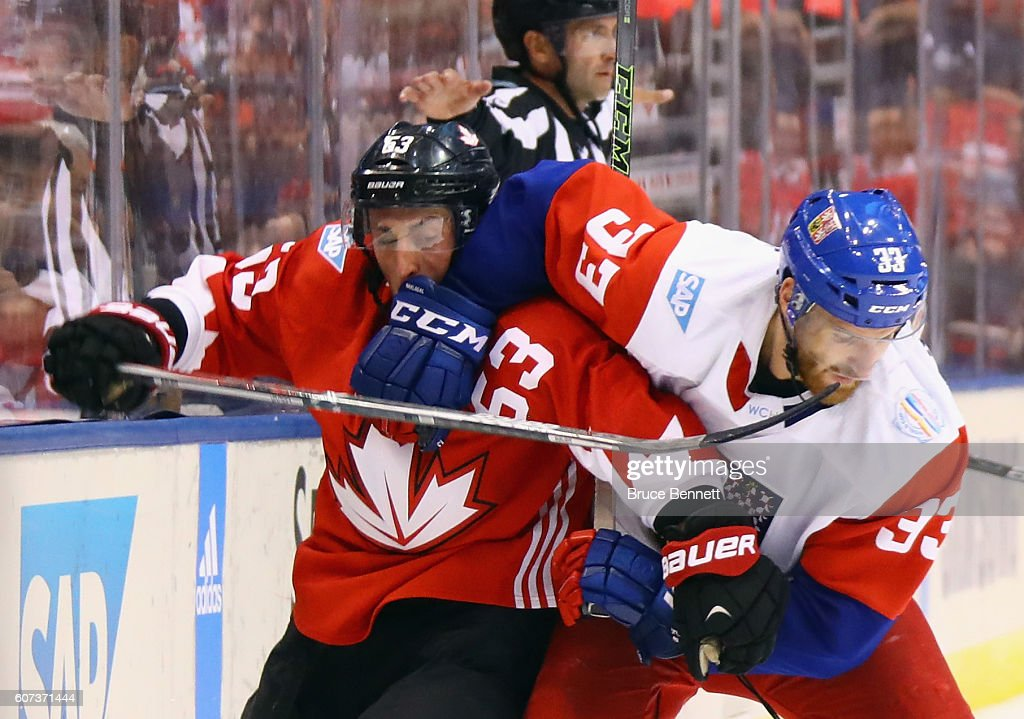 Brad Marchand #63 of Team Canada and Jakub Nakladal #33 of Team Czech Republic battle along the boards during the World Cup of Hockey tournament at the Air Canada Centre on September 17, 2016 in Toronto, Canada. Team Canada defeated Team Czech Republic 6-0.
