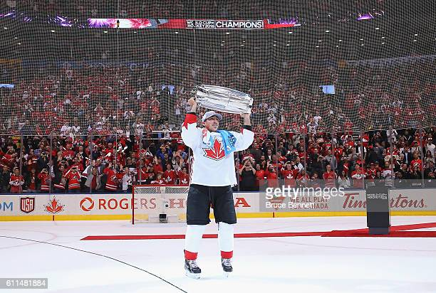Brad Marchand of Team Canada carries the World Cup of Hockey Trophy after Canada defeated Europe 21 during Game Two of the World Cup of Hockey final...