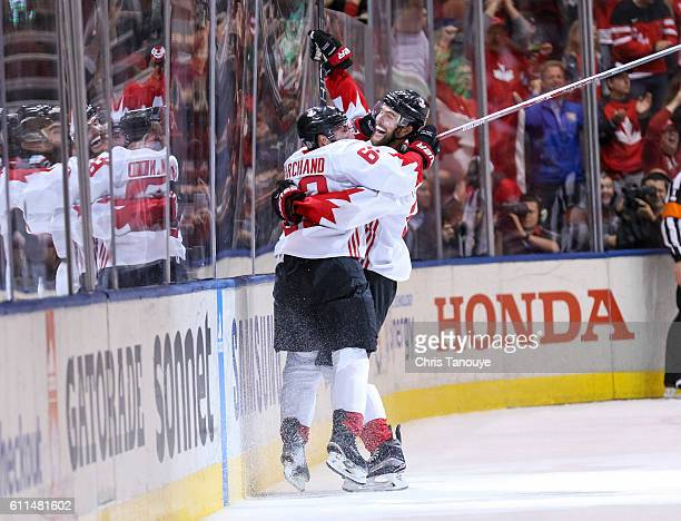 Brad Marchand of Team Canada celebrates his game winning goal with teammate Alex Pietrangelo of Team Canada during Game Two of the World Cup of...