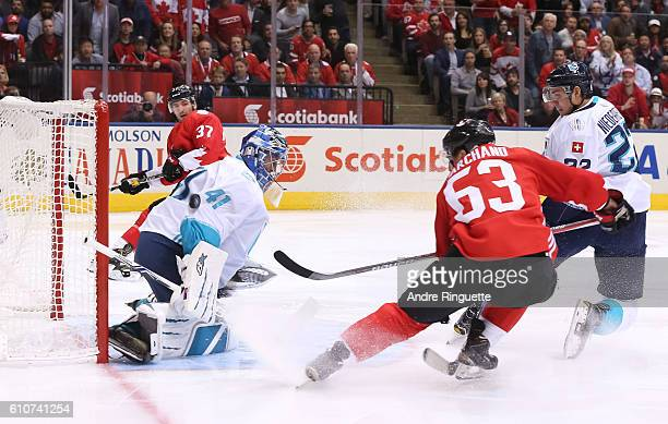 Brad Marchand of Team Canada gets the puck past Jaroslav Halak of Team Europe to score the opening goal of the game during Game One of the World Cup...