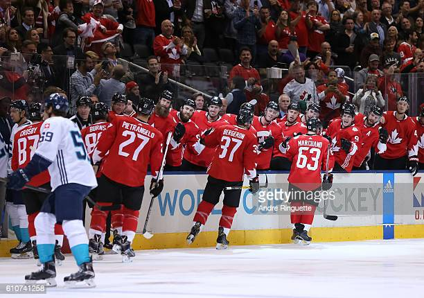 Brad Marchand of Team Canada high fives the bench after scoring a first period goal on Team Europe during Game One of the World Cup of Hockey final...