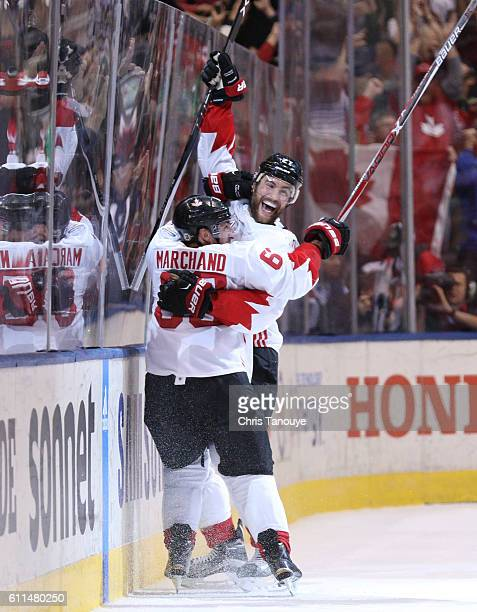 Brad Marchand of Team Canada is congratulated by his teammate Alex Pietrangelo after scoring a third period goal against Team Europe during Game Two...