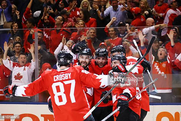 Brad Marchand of Team Canada is congratulated by his teammates Sidney Crosby Drew Doughty Patrice Bergeron and Alex Pietrangelo after scoring a...