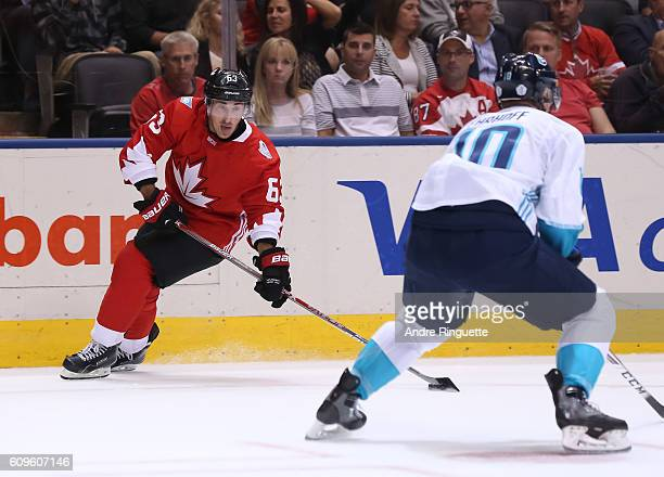 Brad Marchand of Team Canada looks for a pass with pressure from Christian Ehrhoff of Team Europe during the World Cup of Hockey 2016 at Air Canada...