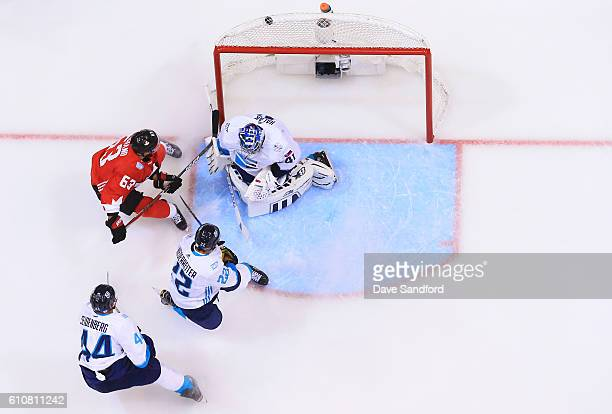 Brad Marchand of Team Canada scores against Jaroslav Halak of Team Europe as both Nino Niederreiter of Team Europe and Dennis Seidenberg of Team...