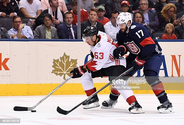 Brad Marchand of Team Canada stickhandles the puck away from Ryan Kesler of Team USA during the World Cup of Hockey 2016 at Air Canada Centre on...