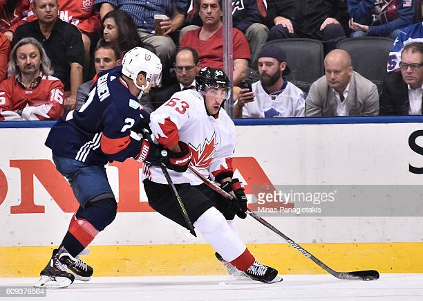 Brad Marchand of Team Canada stickhandles the puck with pressure from Matt Niskanen of Team USA during the World Cup of Hockey 2016 at Air Canada...