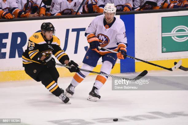 Brad Marchand of the Boston Bruins against Josh Bailey of the New York Islanders at the TD Garden on December 9 2017 in Boston Massachusetts