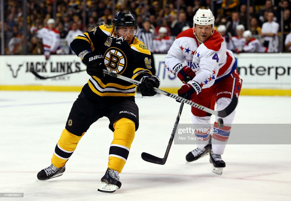<a gi-track='captionPersonalityLinkClicked' href=/galleries/search?phrase=Brad+Marchand&family=editorial&specificpeople=2282544 ng-click='$event.stopPropagation()'>Brad Marchand</a> #63 of the Boston Bruins and <a gi-track='captionPersonalityLinkClicked' href=/galleries/search?phrase=John+Erskine&family=editorial&specificpeople=215268 ng-click='$event.stopPropagation()'>John Erskine</a> #4 of the Washington Capitals go for the puck during a game at the TD Garden on March 1, 2014 in Boston, Massachusetts.