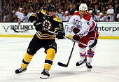 Brad Marchand of the Boston Bruins and John Erskine of the Washington Capitals go for the puck during a game at the TD Garden on March 1 2014 in...