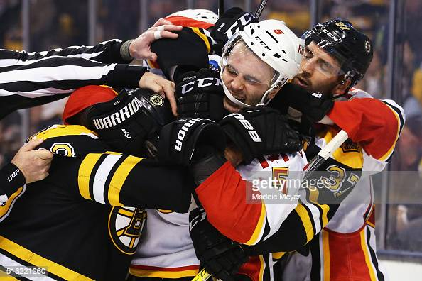 Brad Marchand of the Boston Bruins and Mark Giordano of the Calgary Flames fight during the third period at TD Garden on March 1 2016 in Boston...
