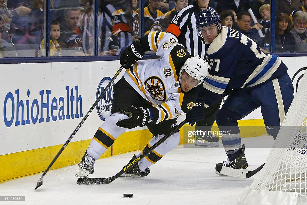 <a gi-track='captionPersonalityLinkClicked' href=/galleries/search?phrase=Brad+Marchand&family=editorial&specificpeople=2282544 ng-click='$event.stopPropagation()'>Brad Marchand</a> #63 of the Boston Bruins and Ryan Murray #27 of the Columbus Blue Jackets battle for control of the puck during the second third period on October 12, 2013 at Nationwide Arena in Columbus, Ohio. Boston defeated Columbus 3-1.