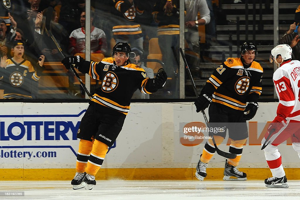 <a gi-track='captionPersonalityLinkClicked' href=/galleries/search?phrase=Brad+Marchand&family=editorial&specificpeople=2282544 ng-click='$event.stopPropagation()'>Brad Marchand</a> #63 of the Boston Bruins celebrates a goal against the Detroit Red Wings at the TD Garden on October 5, 2013 in Boston, Massachusetts.