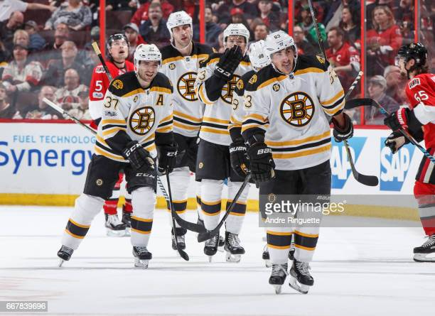 Brad Marchand of the Boston Bruins celebrates his third period goal against the Ottawa Senators in Game One of the Eastern Conference First Round...