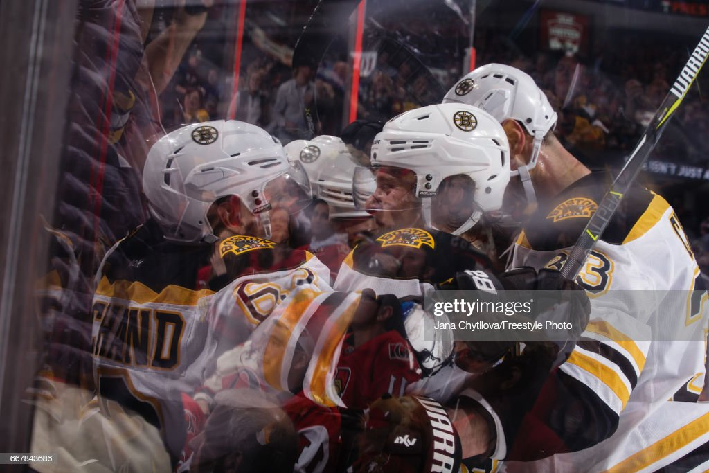 Brad Marchand #63 of the Boston Bruins celebrates his third-period, game-winning goal against the Ottawa Senators with teammate Zdeno Chara #33 in Game One of the Eastern Conference First Round during the 2017 NHL Stanley Cup Playoffs at Canadian Tire Centre on April 12, 2017 in Ottawa, Ontario, Canada.