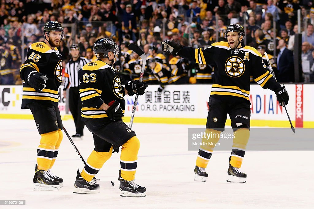Brad Marchand of the Boston Bruins celebrates with Kevan Miller and Patrice Bergeron after scoring against the Detroit Red Wings during the first...