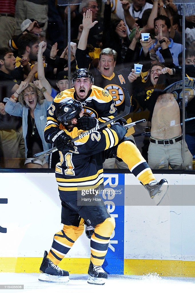 Brad Marchand of the Boston Bruins celebrates with teammate Andrew Ference after scoring a goal in the second period against Roberto Luongo of the...
