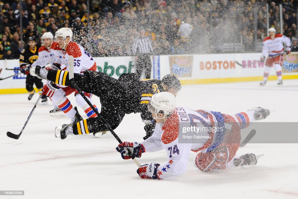 <a gi-track='captionPersonalityLinkClicked' href=/galleries/search?phrase=Brad+Marchand&family=editorial&specificpeople=2282544 ng-click='$event.stopPropagation()'>Brad Marchand</a> #63 of the Boston Bruins collides with John Carlson #74 of the Washington Capitals at the TD Garden on March 16, 2013 in Boston, Massachusetts.