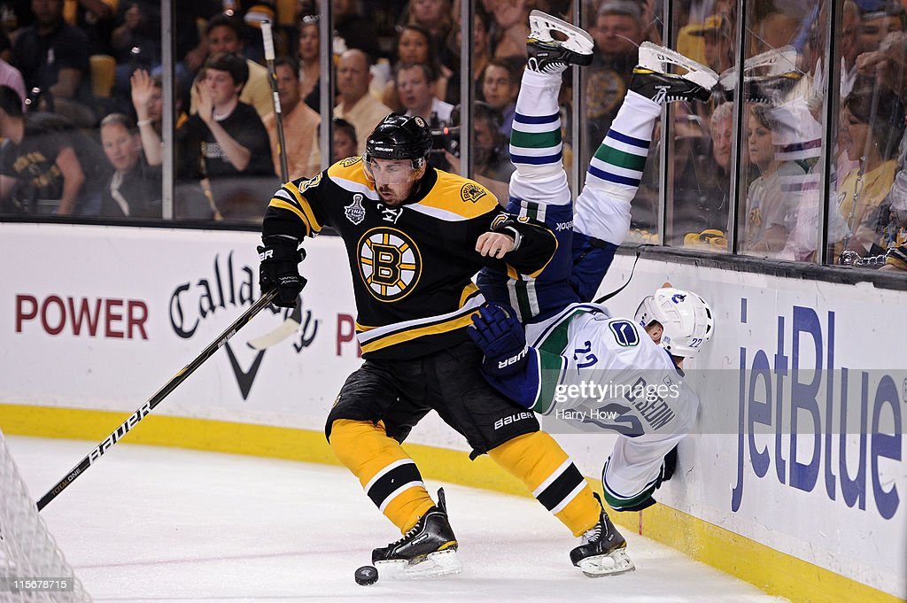 <a gi-track='captionPersonalityLinkClicked' href=/galleries/search?phrase=Brad+Marchand&family=editorial&specificpeople=2282544 ng-click='$event.stopPropagation()'>Brad Marchand</a> #63 of the Boston Bruins dodges <a gi-track='captionPersonalityLinkClicked' href=/galleries/search?phrase=Daniel+Sedin&family=editorial&specificpeople=202492 ng-click='$event.stopPropagation()'>Daniel Sedin</a> #22 of the Vancouver Canucks during Game Four of the 2011 NHL Stanley Cup Final at TD Garden on June 8, 2011 in Boston, Massachusetts.