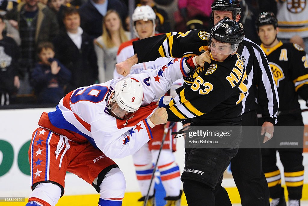 <a gi-track='captionPersonalityLinkClicked' href=/galleries/search?phrase=Brad+Marchand&family=editorial&specificpeople=2282544 ng-click='$event.stopPropagation()'>Brad Marchand</a> #63 of the Boston Bruins fights against <a gi-track='captionPersonalityLinkClicked' href=/galleries/search?phrase=Mike+Ribeiro&family=editorial&specificpeople=203275 ng-click='$event.stopPropagation()'>Mike Ribeiro</a> #9 of the Washington Capitals at the TD Garden on March 16, 2013 in Boston, Massachusetts.