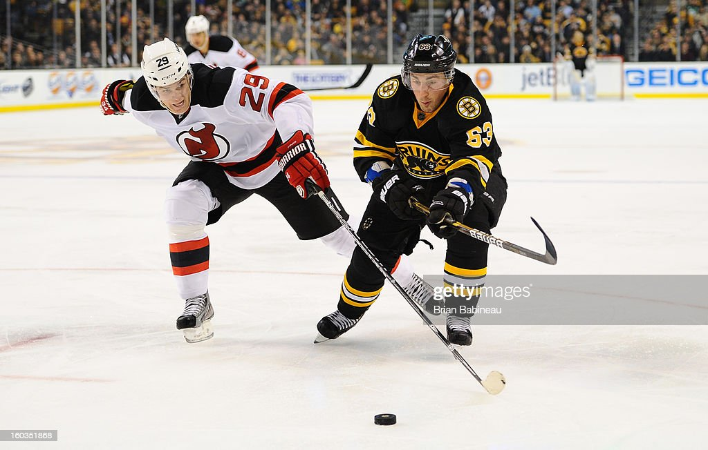 <a gi-track='captionPersonalityLinkClicked' href=/galleries/search?phrase=Brad+Marchand&family=editorial&specificpeople=2282544 ng-click='$event.stopPropagation()'>Brad Marchand</a> #63 of the Boston Bruins fights for the puck against Mark Fayne #29 of the New Jersey Devils at the TD Garden on January 29, 2013 in Boston, Massachusetts.
