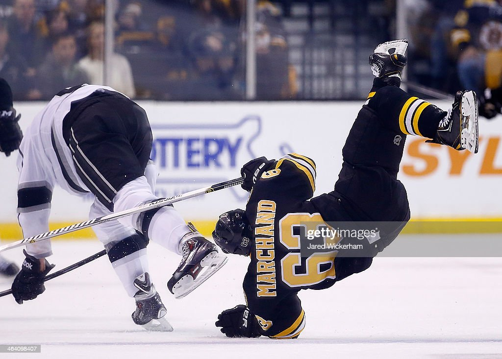 <a gi-track='captionPersonalityLinkClicked' href=/galleries/search?phrase=Brad+Marchand&family=editorial&specificpeople=2282544 ng-click='$event.stopPropagation()'>Brad Marchand</a> #63 of the Boston Bruins flips over a member of the Los Angeles Kings in the third period during the game at TD Garden on January 20, 2014 in Boston, Massachusetts.