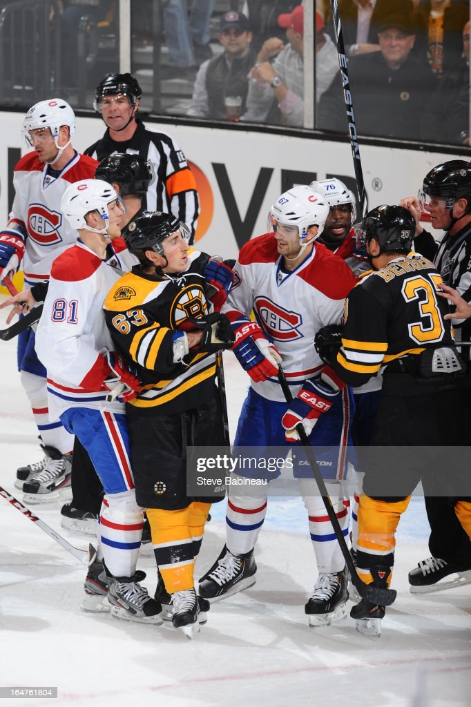 <a gi-track='captionPersonalityLinkClicked' href=/galleries/search?phrase=Brad+Marchand&family=editorial&specificpeople=2282544 ng-click='$event.stopPropagation()'>Brad Marchand</a> #63 of the Boston Bruins gets in a scuffle against <a gi-track='captionPersonalityLinkClicked' href=/galleries/search?phrase=Max+Pacioretty&family=editorial&specificpeople=4324972 ng-click='$event.stopPropagation()'>Max Pacioretty</a> #67 of the Montreal Canadiens at the TD Garden on March 27, 2013 in Boston, Massachusetts.