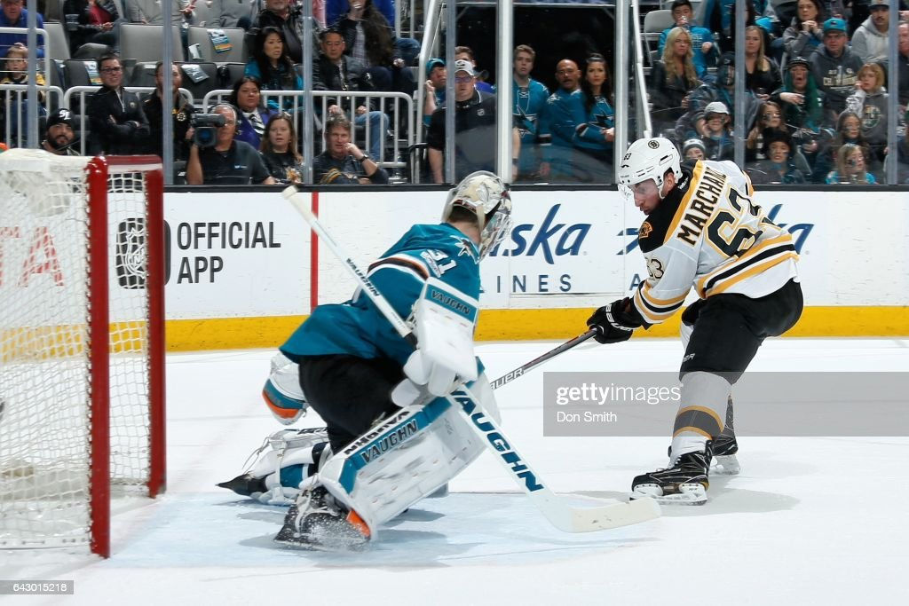 Brad Marchand #63 of the Boston Bruins gets one by Martin Jones #31of the San Jose Sharks to score the win in overtime at SAP Center at San Jose on February 19, 2017 in San Jose, California.