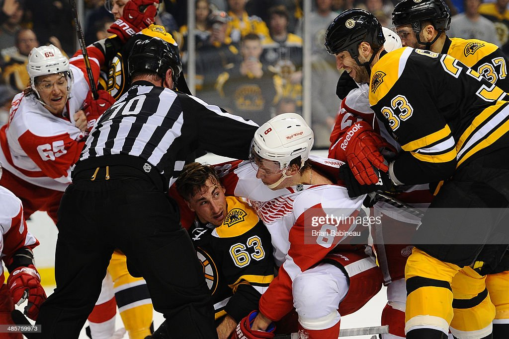 <a gi-track='captionPersonalityLinkClicked' href=/galleries/search?phrase=Brad+Marchand&family=editorial&specificpeople=2282544 ng-click='$event.stopPropagation()'>Brad Marchand</a> #63 of the Boston Bruins gets pinned down by <a gi-track='captionPersonalityLinkClicked' href=/galleries/search?phrase=Justin+Abdelkader&family=editorial&specificpeople=2271858 ng-click='$event.stopPropagation()'>Justin Abdelkader</a> #8 of the Detroit Red Wings in Game Two of the First Round of the 2014 Stanley Cup Playoffs at TD Garden on April 20, 2014 in Boston, Massachusetts.