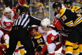 Brad Marchand of the Boston Bruins gets pinned down by Justin Abdelkader of the Detroit Red Wings in Game Two of the First Round of the 2014 Stanley...