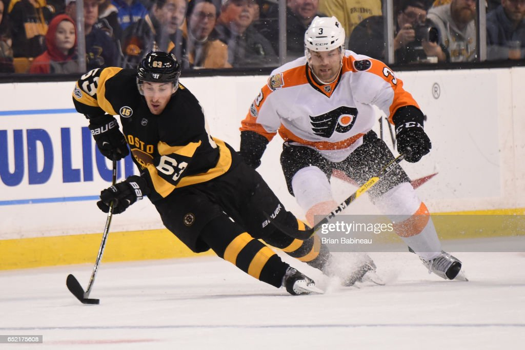 Brad Marchand #63 of the Boston Bruins handles the puck against Radko Gudas #3 of the Philadelphia Flyers at the TD Garden on March 11, 2017 in Boston, Massachusetts.