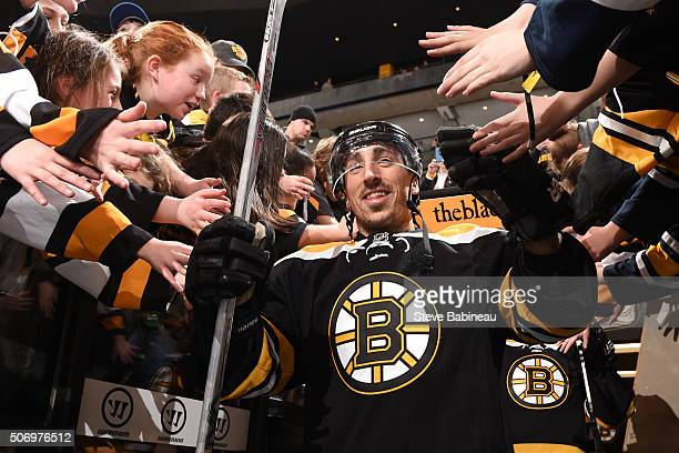 Brad Marchand of the Boston Bruins high fives fans on his way to warm ups before the game against the Anaheim Ducks at the TD Garden on January 26...